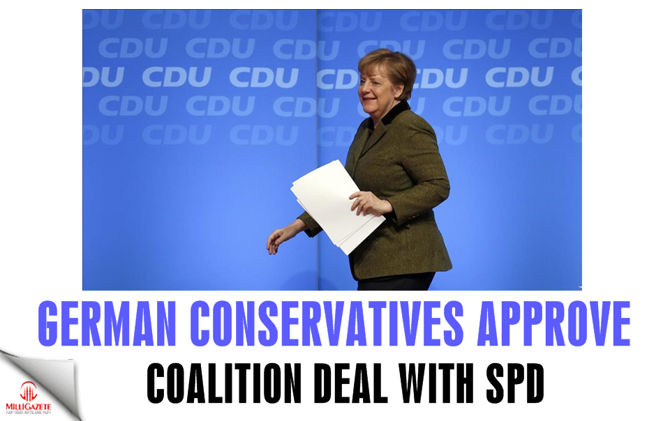 German conservatives approve coalition deal with SPD