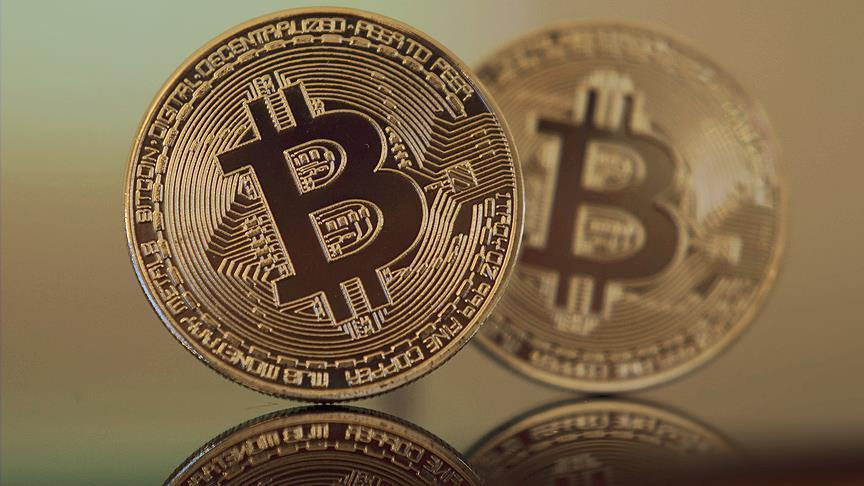 Bitcoin drops 13 percent to below $9,000