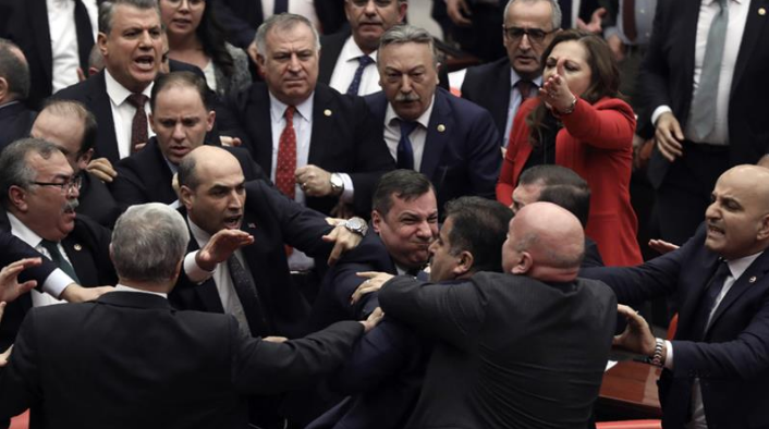 Brawl in Turkey's parliament after MP criticises Erdogan