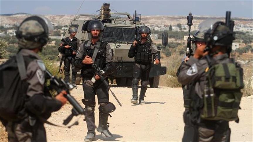 Occupier Israel detains 18 Palestinians in West Bank raids