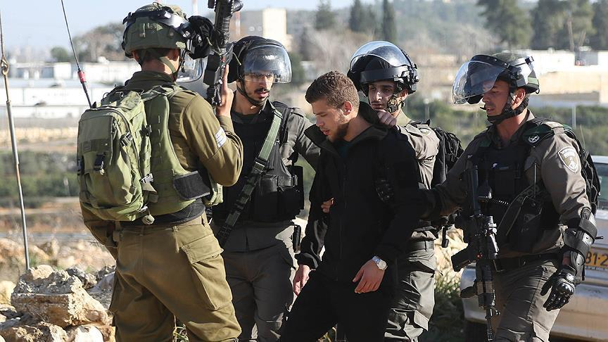 Occupier Israel detains 21 Palestinians in West Bank raids