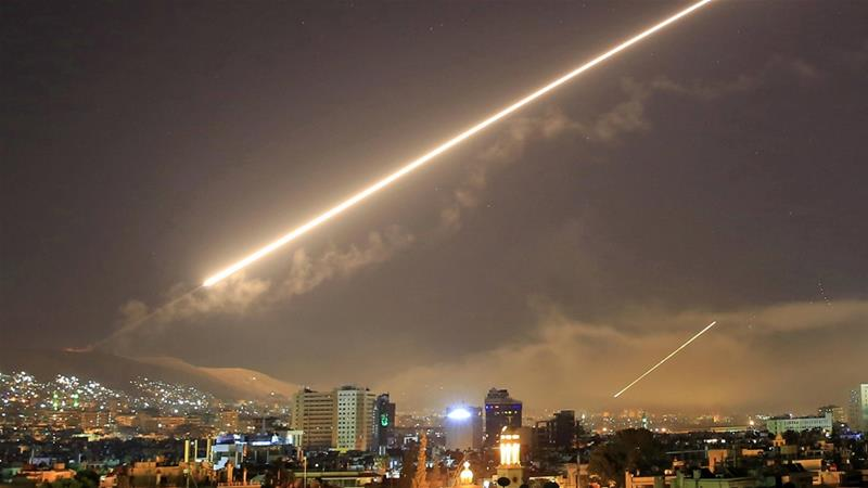 Syria air defences 'confront Israeli missiles' near Damascus