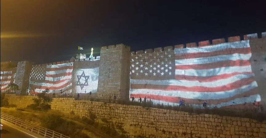 The US and Israeli flags projected onto the Jerusalem walls