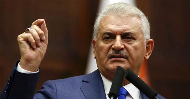 Turkish PM criticizes Clinton for vowing to arm Syrian Kurds